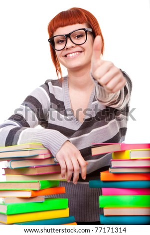 girl with pile book showing thumb up, isolated on white background