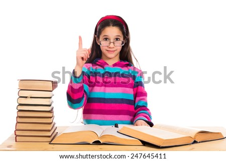 Girl with pile of old books and finger raised up, isolated on white - stock photo