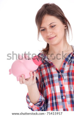 girl with pink piggy bank - stock photo