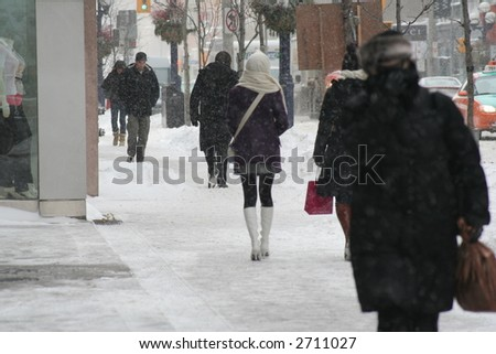 girl with pretty legs walking in the snow toronto canada - stock photo