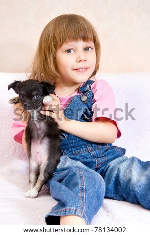 Girl with puppy in hand