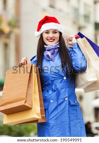 Girl with purchases at street during the Christmas sales