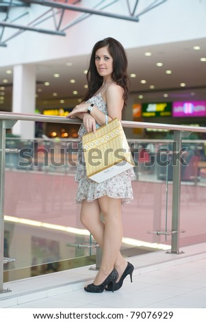 girl with purchases in the big shopping center