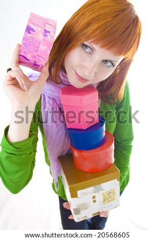 girl with pyramid from gifts - stock photo