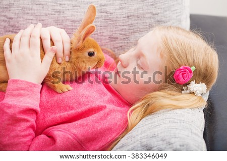 girl with rabbit outdoor - stock photo