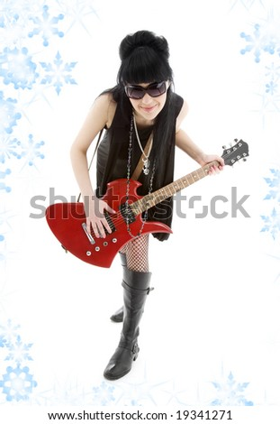 girl with red electric guitar and snowflakes - stock photo