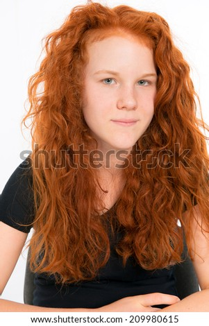 girl with red hair is looking friendly in to the camera