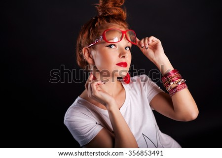 girl with red hair wearing glasses