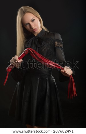 girl with red leather whip  - stock photo