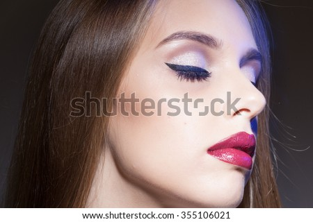 girl with red lips close her eyes