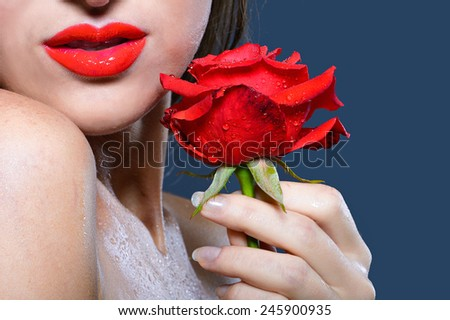 girl with red lips holding a red rose - stock photo