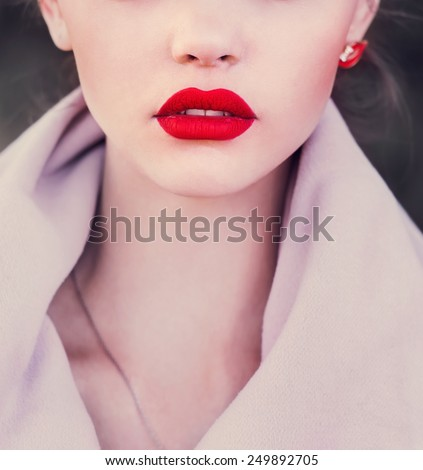 Girl with red lips. Photo in violet tones - stock photo