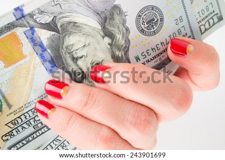 girl with red manicure gives money. denominations hundred dollars - stock photo