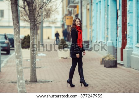 Girl with red scarf in the old city