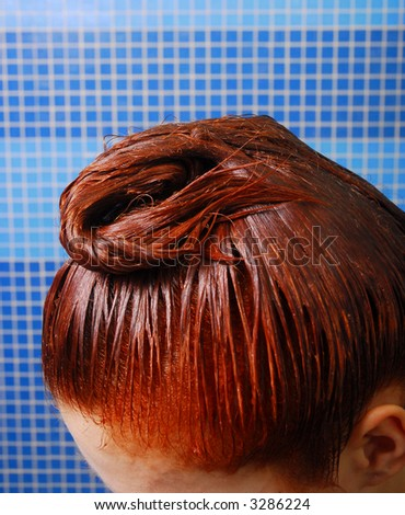 Girl with red wet dyeing hair 7 - stock photo
