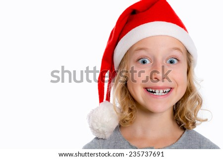 girl with Santa- cap is grin - stock photo