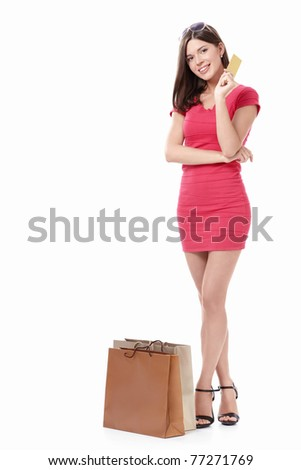 Girl with shopping bags and credit card on a white background - stock photo