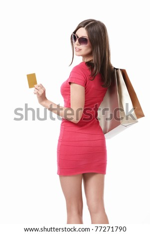 Girl with shopping bags and credit cards in sunglasses on white background - stock photo