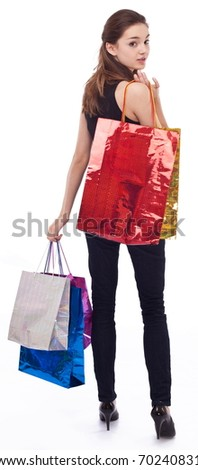Girl with shopping bags on a white background. - stock photo