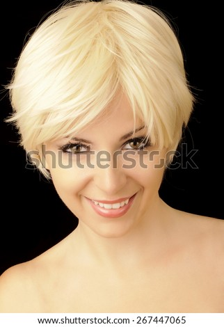 Girl with short blond hair - stock photo