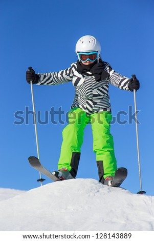 Girl with ski on the mountain - stock photo