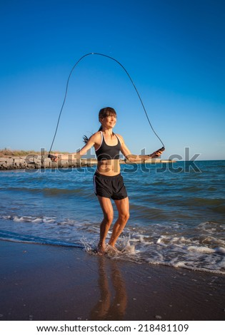girl with skipping rope  - stock photo