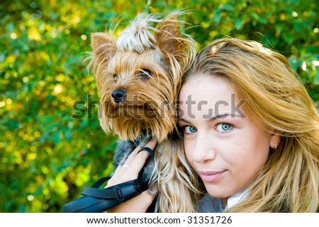 Girl with smaller dog - stock photo