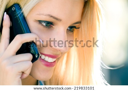 Girl with smart phone - stock photo