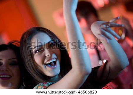 Girl with smile and her girlfriend - stock photo