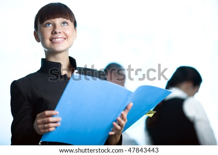 Girl with smile and with blue folder - stock photo