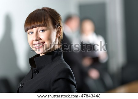 Girl with smile in black jacket - stock photo