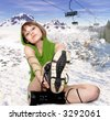 girl with snowboard Boots over the mountain background - stock photo