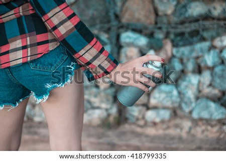 girl with spray can in hand  - stock photo