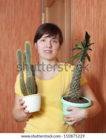 Girl with succulent plant in the pots at her home - stock photo