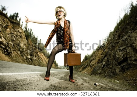 girl with suitcase stops the car
