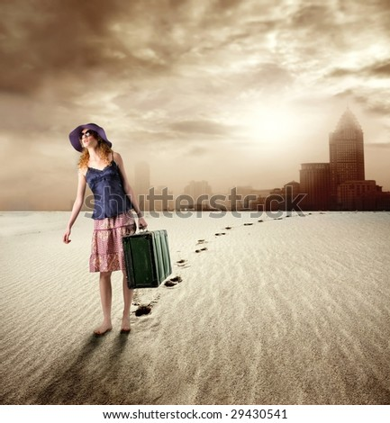 girl with suitcase walking in a desert and leaving a city - stock photo