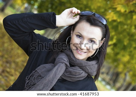 Girl with sunglasses - autumn time. - stock photo