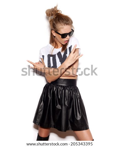 Girl with sunglasses giving the Rock and Roll sign.  White background, not isolated - stock photo