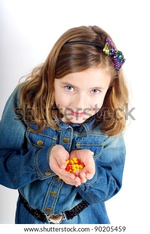 Girl with sweets/tablets - stock photo
