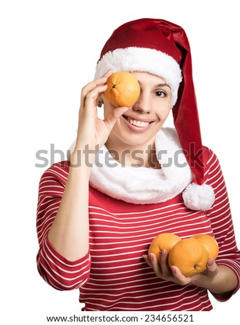 girl with tangerines in Santa hats