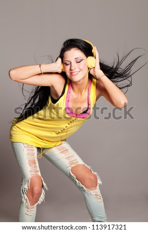 Girl with tank top listening to the music - stock photo