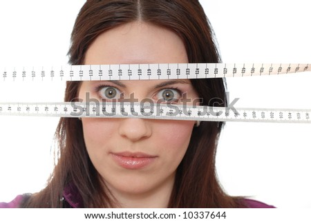 Girl with tape-line - stock photo
