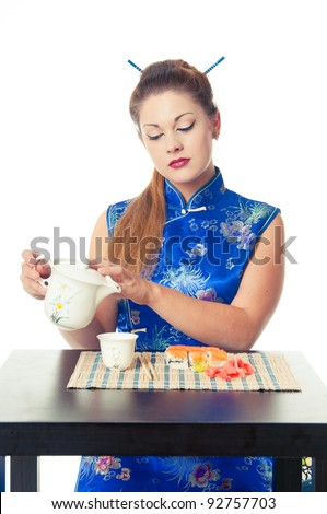 girl with tea and sushi - stock photo