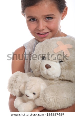 Girl with teddy wounded - stock photo