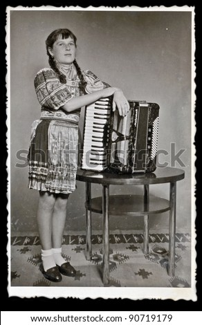 girl with the accordion - photo scan - about 1955 - stock photo