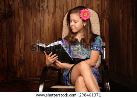 Girl with the book in vintage style