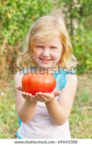 girl with tomato - stock photo