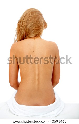 Girl with towel sitting on the floor - rare view - over white - stock photo