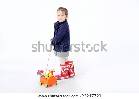 Girl with toy - stock photo