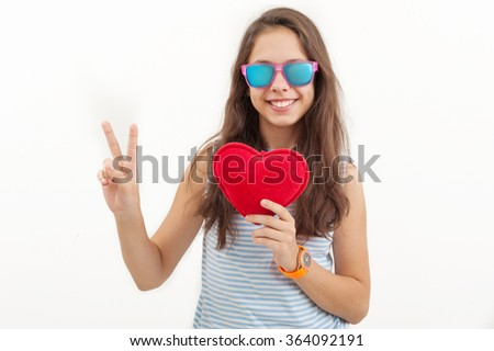 Girl with toy heart - stock photo
